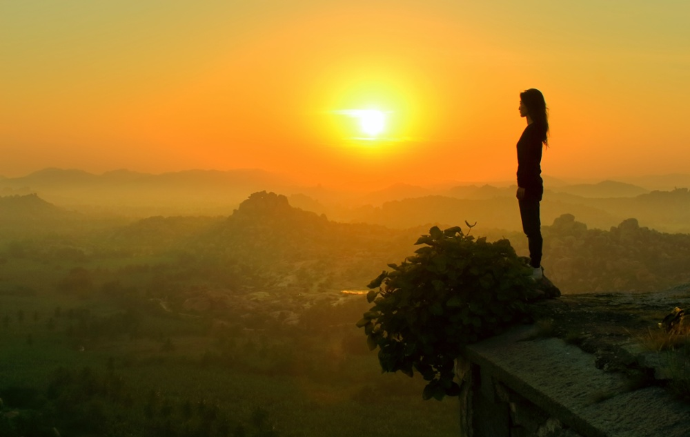 Woman looking at sunset with beautiful view